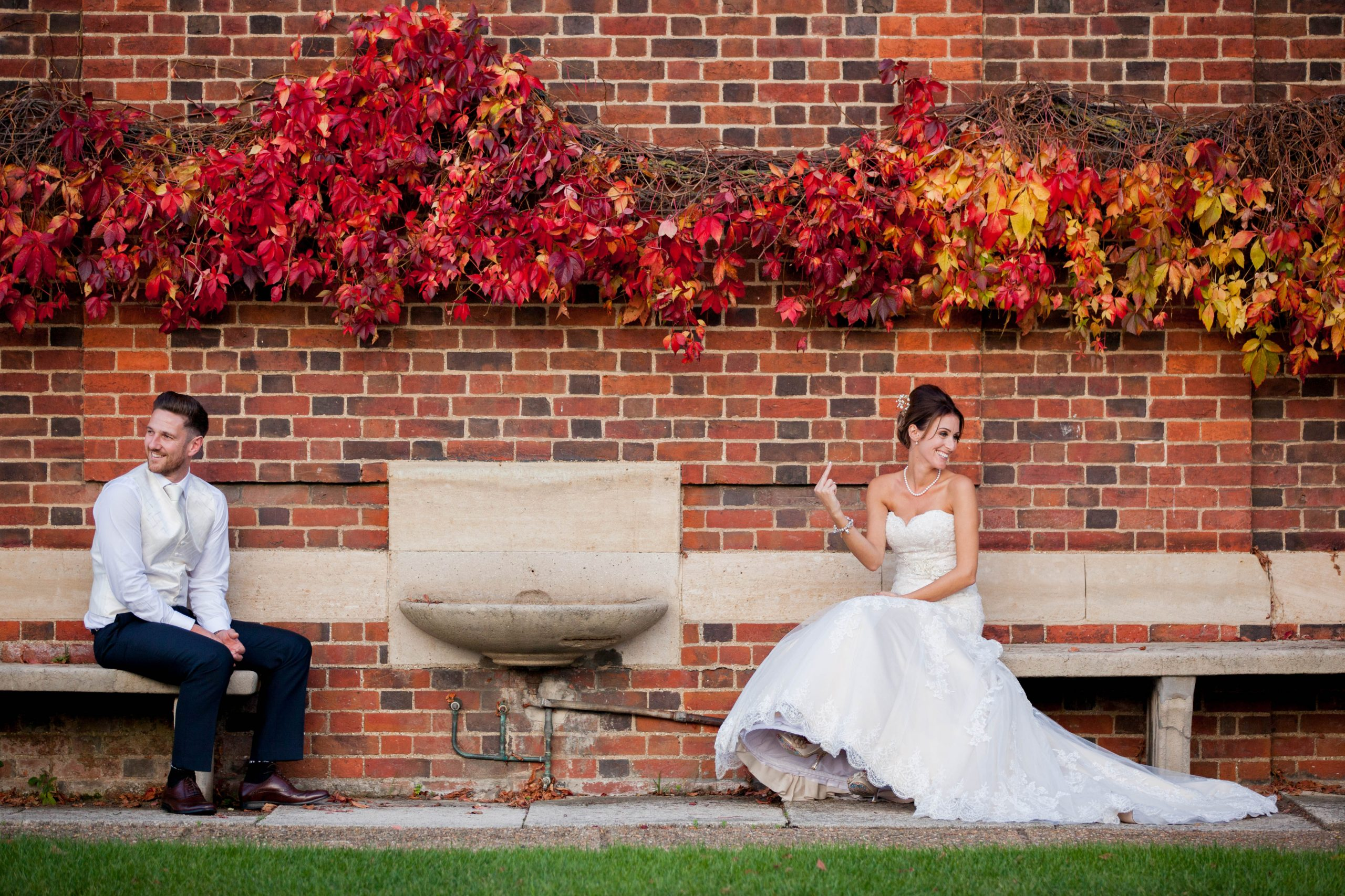 illustrate benefits of a second photographer with swearing bride