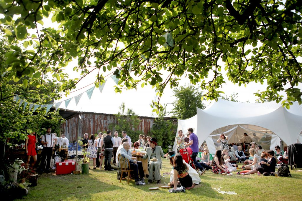 shows bride and groom at wedding bbq picnic at diy wedding