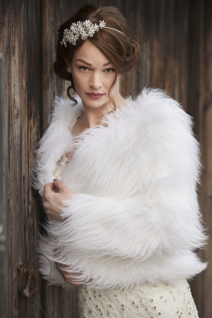 Bride in faux fur jacket on winter wedding day photography