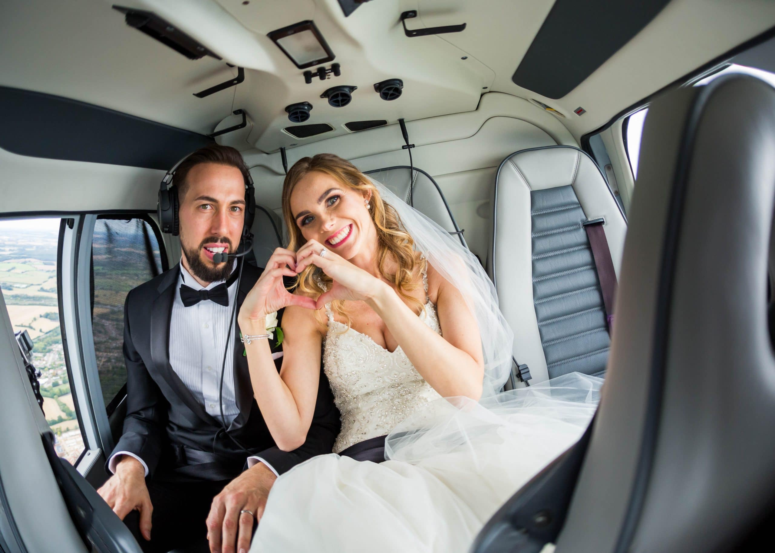 S&L couple in helicopter on classic real wedding day