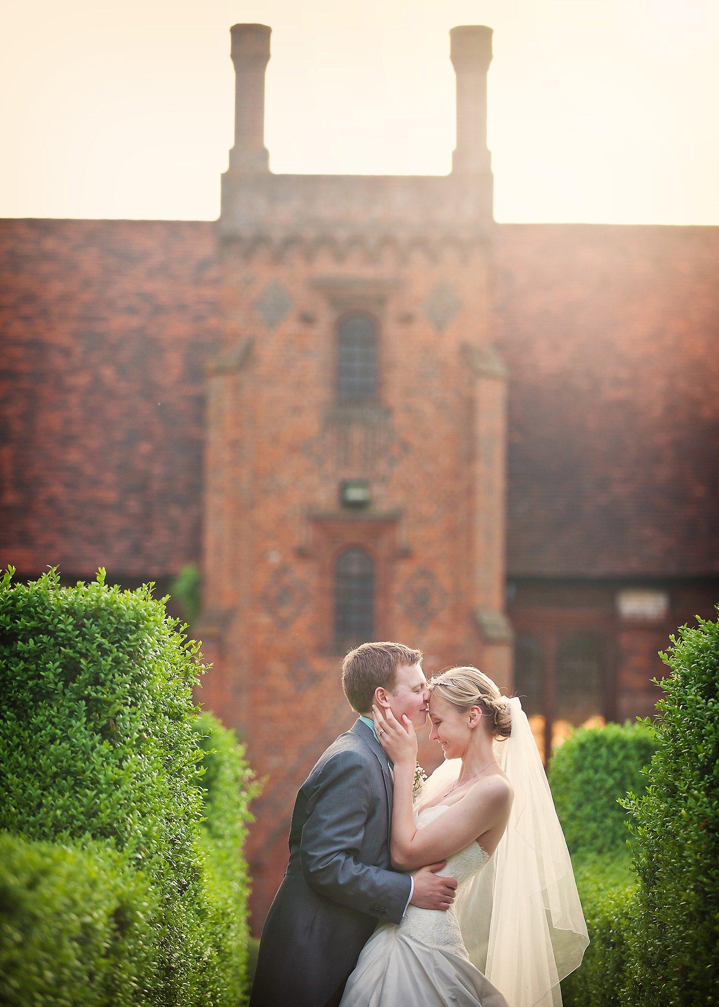 wedding couple kissing hatfield house wedding photography esme robinson